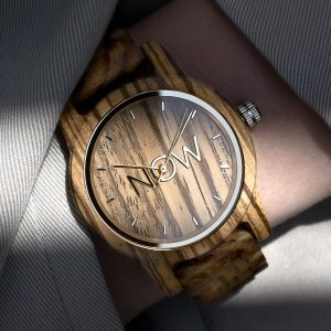 NOW golden dial on hand 2