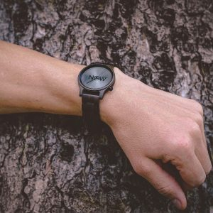NOW Watch made of Black Sandalwood on man's hand
